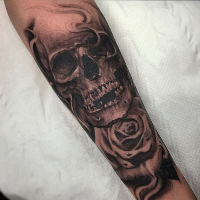 Skull and rose completed today on the inner forearm for Rose and skull tattoos