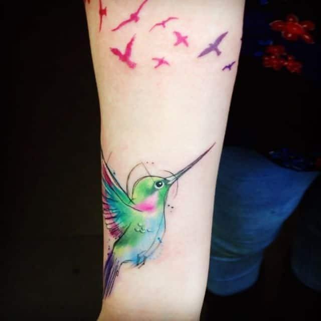 naiomitattoo colorful colortattoo besttattooartists hummingbirdwatercolortattoo watercolor watercolorart studioxiii