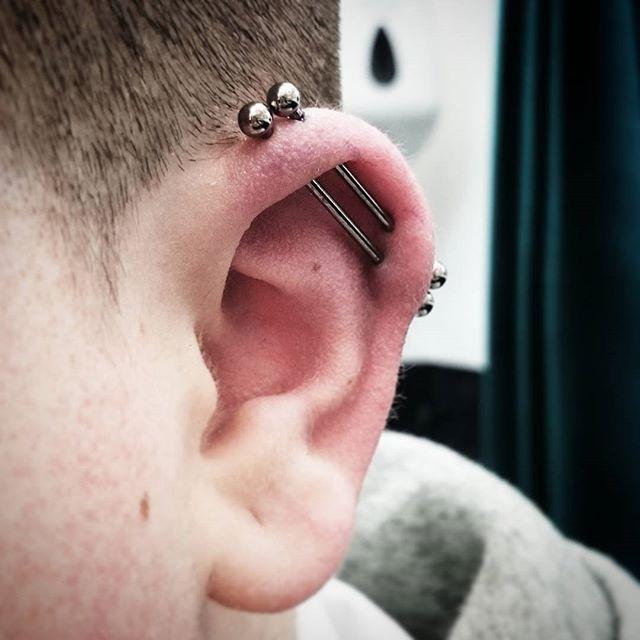 One partially healed, one fresh industrial.  One tough customer!!!!! stxiii studioxiii studioxiiigallery earpiercing cartilagepiercing industrialpiercing scaffoldpiercing piercing piercings instapiercing piercingsofinstagram