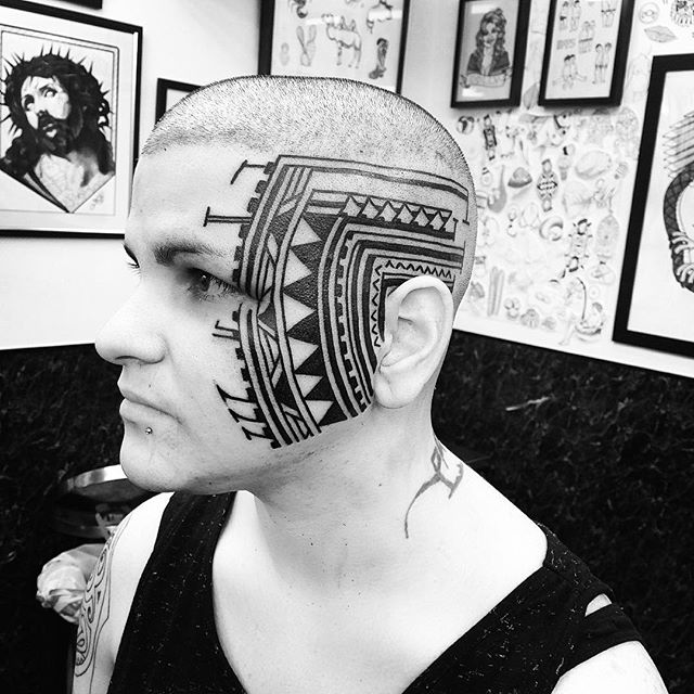 Not every girl wants a mandala ☠️ Thank you Maddelena!! @savageblacktattoos polynesian inspired blackwork blackworkerssubmission tribal headtattoo facetattoo @studioxiiigallery studioxiii