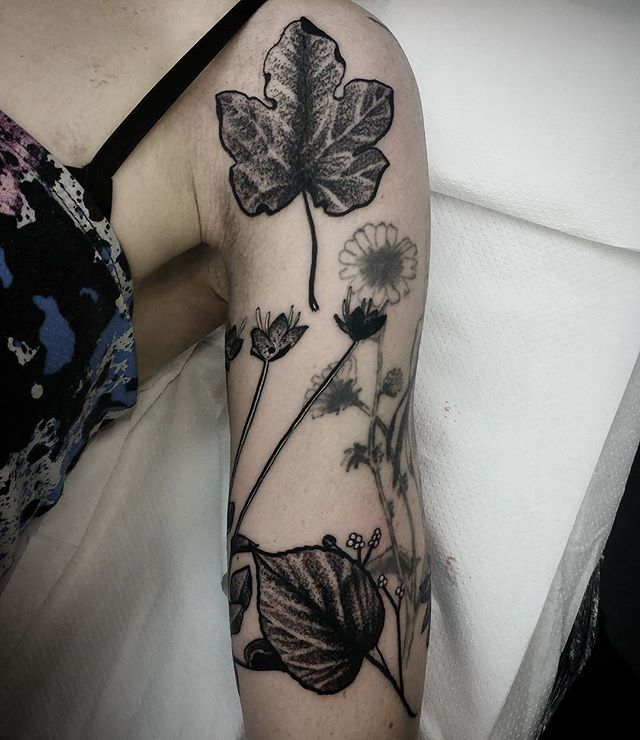 In progress fixup/ coverup blackwork leaves and flowers tattoo here at studioxiii in Edinburgh Scotland