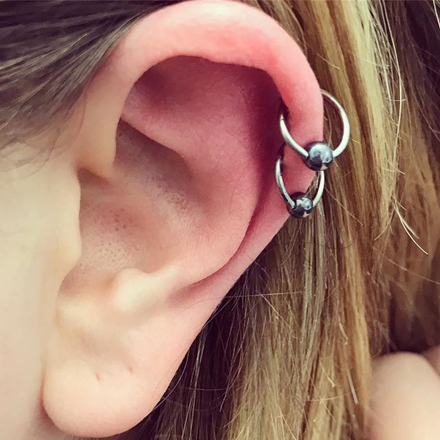 The always popular double helix piercings on my fabulous customer @studioxiiigallery piercer piercing ladypiercer helixpiercing titanium scotland edinburghpiercer  edinburgh studioxiii titanium bcr piercedandproud girlswithpiercings piercingsofinstagram