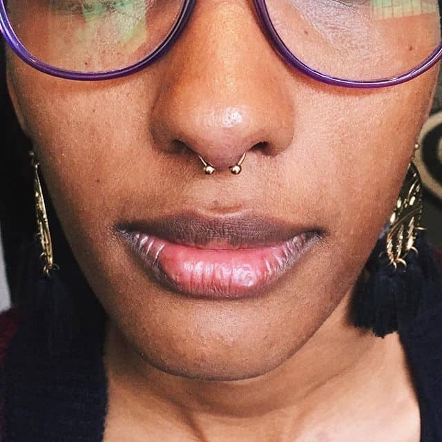 This babe got her septum pierced today with this cute lil&039; gold horseshoe! Totally rocking it