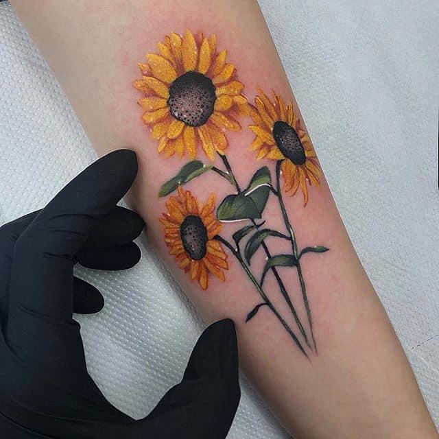 Small  sunflowers Adrianarmonfort@gmail.com——————————————————— edinburgh edinburghtattoos tattoo scotland tatted tattoos tattooed tattooer studioxiii tattooing tattooculture tattooart tattooshop tattooist ink inked inkedup instart instatattoo follow neotradeu neotradsub neotraditional picoftheday tattoo4life miniature flowers