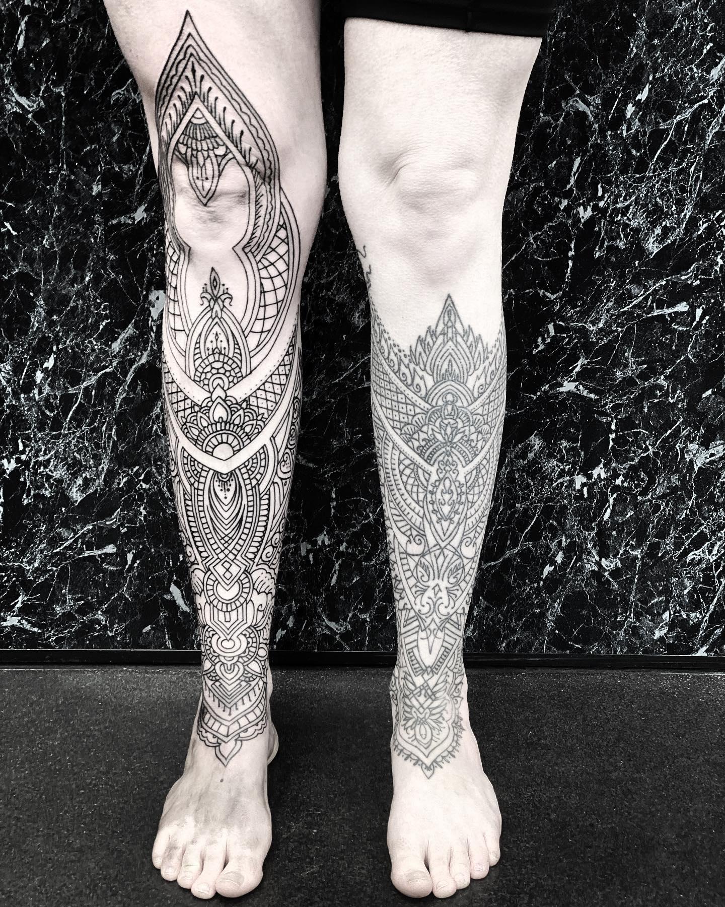 Beautiful shin to knee outline ornamental to match her other side. Thank you for your continued support @amanda.joshi 🖤 SWIPE to see ipadpro mockup.  @studioxiiigallery studioxiii tattoosforgirls lineworktattoo edinburghtattooartist